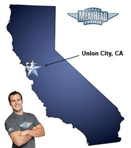 An arrow pointing to the city of Union City on a map of California with an athletic Meathead Mover standing happily next to the state.