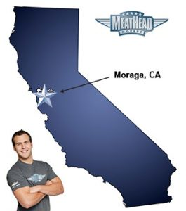 An arrow pointing to the city of Moraga on a map of California with an athletic Meathead Mover standing happily next to the state.