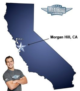 An arrow pointing to the city of Morgan Hill on a map of California with an athletic Meathead Mover standing happily next to the state.