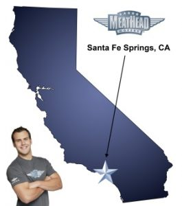 An arrow pointing to the city of Santa Fe Springs on a map of California with an athletic Meathead Mover standing happily next to the state.