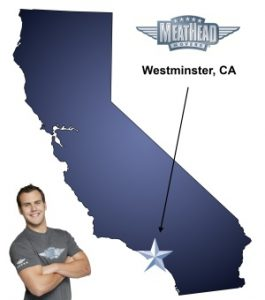 An arrow pointing to the city of Westminister on a map of California with an athletic Meathead Mover standing happily next to the state.
