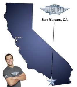 An arrow pointing to the city of San Marcos on a map of California with an athletic Meathead Mover standing happily next to the state.