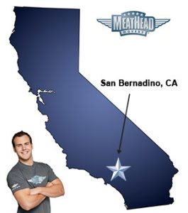 An arrow pointing to the city of San Bernardino on a map of California with an athletic Meathead Mover standing happily next to the state.