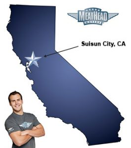 An arrow pointing to the city of Suisin City on a map of California with an athletic Meathead Mover standing happily next to the state.