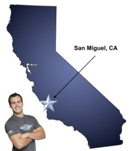 An arrow pointing to the city of San Miguel on a map of California with an athletic Meathead Mover standing happily next to the state.