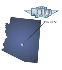An arrow pointing to the city of Phoenix on a map of Arizona with the Meathead Movers logo hovering over the state.