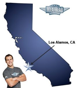 An arrow pointing to the city of Los Alamos on a map of California with an athletic Meathead Mover standing happily next to the state.