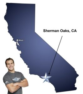 An arrow pointing to the city of Sherman Oaks on a map of California with an athletic Meathead Mover standing happily next to the state.