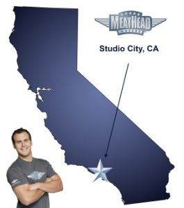 An arrow pointing to the city of Studio City on a map of California with an athletic Meathead Mover standing happily next to the state.
