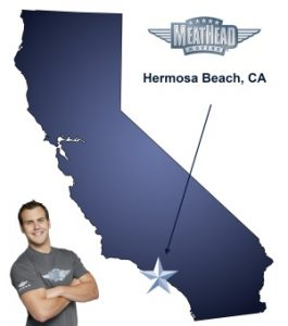 An arrow pointing to the city of Hermosa Beach on a map of California with an athletic Meathead Mover standing happily next to the state.