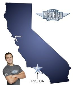 An arrow pointing to the city of Piru on a map of California with an athletic Meathead Mover standing happily next to the state.