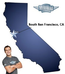 An arrow pointing to the city of South San Francisco on a map of California with an athletic Meathead Mover standing happily next to the state.