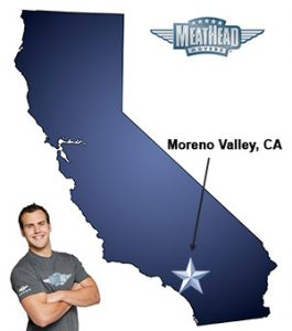 An arrow pointing to the city of Moreno Valley on a map of California with an athletic Meathead Mover standing happily next to the state.