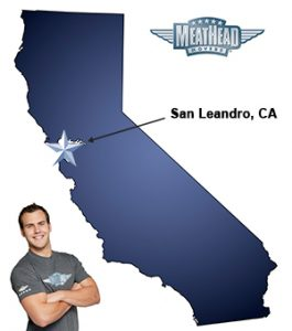 An arrow pointing to the city of San Leandro on a map of California with an athletic Meathead Mover standing happily next to the state.