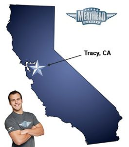 An arrow pointing to the city of Tracy on a map of California with an athletic Meathead Mover standing happily next to the state.