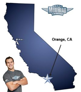 An arrow pointing to the city of Orange on a map of California with an athletic Meathead Mover standing happily next to the state.