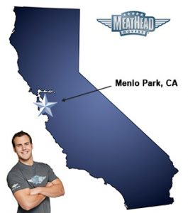 An arrow pointing to the city of Menlo Park on a map of California with an athletic Meathead Mover standing happily next to the state.