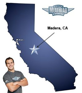 An arrow pointing to the city of Madera on a map of California with an athletic Meathead Mover standing happily next to the state.