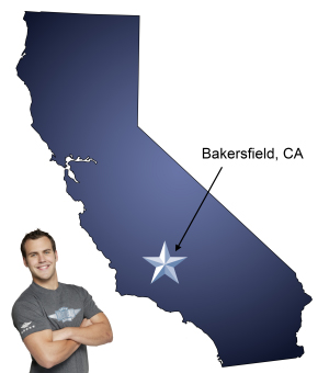 An arrow pointing to the city of Bakersfield on a map of California, with a Meathead Mover standing happily next to the state.