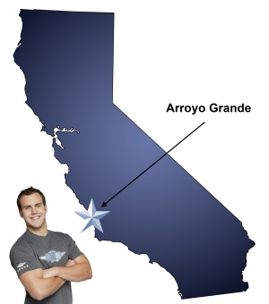 An arrow pointing to the city of Arroyo Grande on a map of California with an athletic Meathead Mover standing happily next to the state.