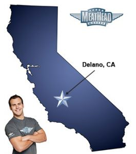 An arrow pointing to the city of Delano on a map of California with an athletic Meathead Mover standing happily next to the state.