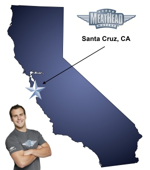 An arrow pointing to the city of Santa Cruz on a map of California with an athletic Meathead Mover standing happily next to the state.