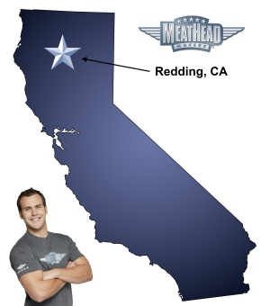 An arrow pointing to the city of Redding on a map of California with a Meathead Mover standing happily next to the state.