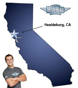 An arrow pointing to the city of Healdsburg on a map of California with an athletic Meathead Mover standing happily next to the state.