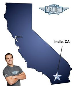 An arrow pointing to the city of Indio on a map of California with an athletic Meathead Mover standing happily next to the state.