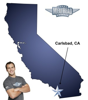 An arrow pointing to the city of Carlsbad on a map of California with an athletic Meathead Mover standing happily next to the state.