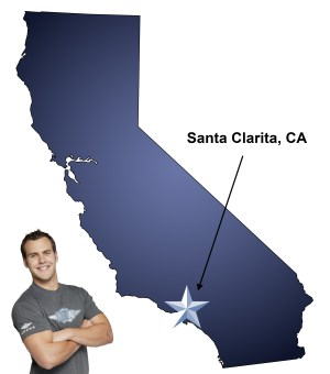 An arrow pointing to the city of Santa Clarita on a map of California with an athletic Meathead Mover standing happily next to the state.