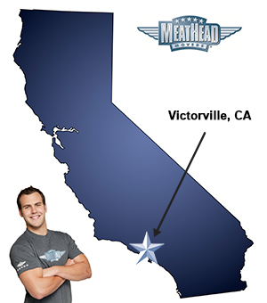 An arrow pointing to the city of Victorville on a map of California with an athletic Meathead Mover standing happily next to the state.