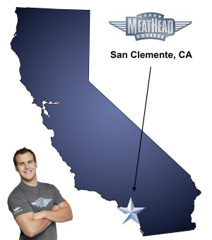 An arrow pointing to the city of San Clemente on a map of California with an athletic Meathead Mover standing happily next to the state.