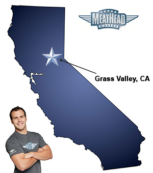 An arrow pointing to the city of Grass Valley on a map of California with an athletic Meathead Mover standing happily next to the state.