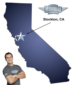 An arrow pointing to the city of Stockton on a map of California with an athletic Meathead Mover standing happily next to the state.