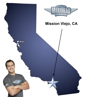 An arrow pointing to the city of Mission Viejo on a map of California with an athletic Meathead Mover standing happily next to the state.
