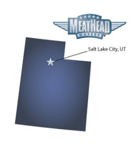 An arrow pointing to the city of Salt Lake City on a map of Utah with an athletic Meathead Mover standing happily next to the state.