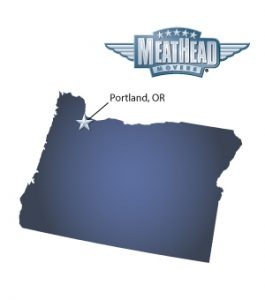 An arrow pointing to the city of Portland on a map of Oregon with the Meathead Movers logo hovering above the state.