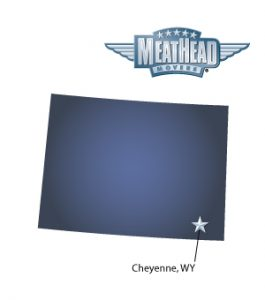 An arrow pointing to the city of Cheyenne on a map of Wyoming with the Meathead Movers logo hovering above the state.
