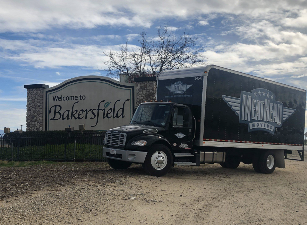 Meathead moving truck parked in front of a Bakersfield city sign